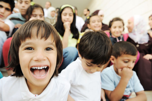 children smiling and laughing
