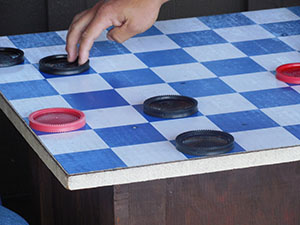 Checkers game board with checkers on it