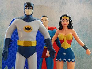 Batman, Superman, and Wonder Woman figurines