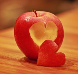 Apple with a heart carved in it